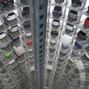 vehicles parked inside elevated parking lot 63294 1 180x180 - Leasing z GPS
